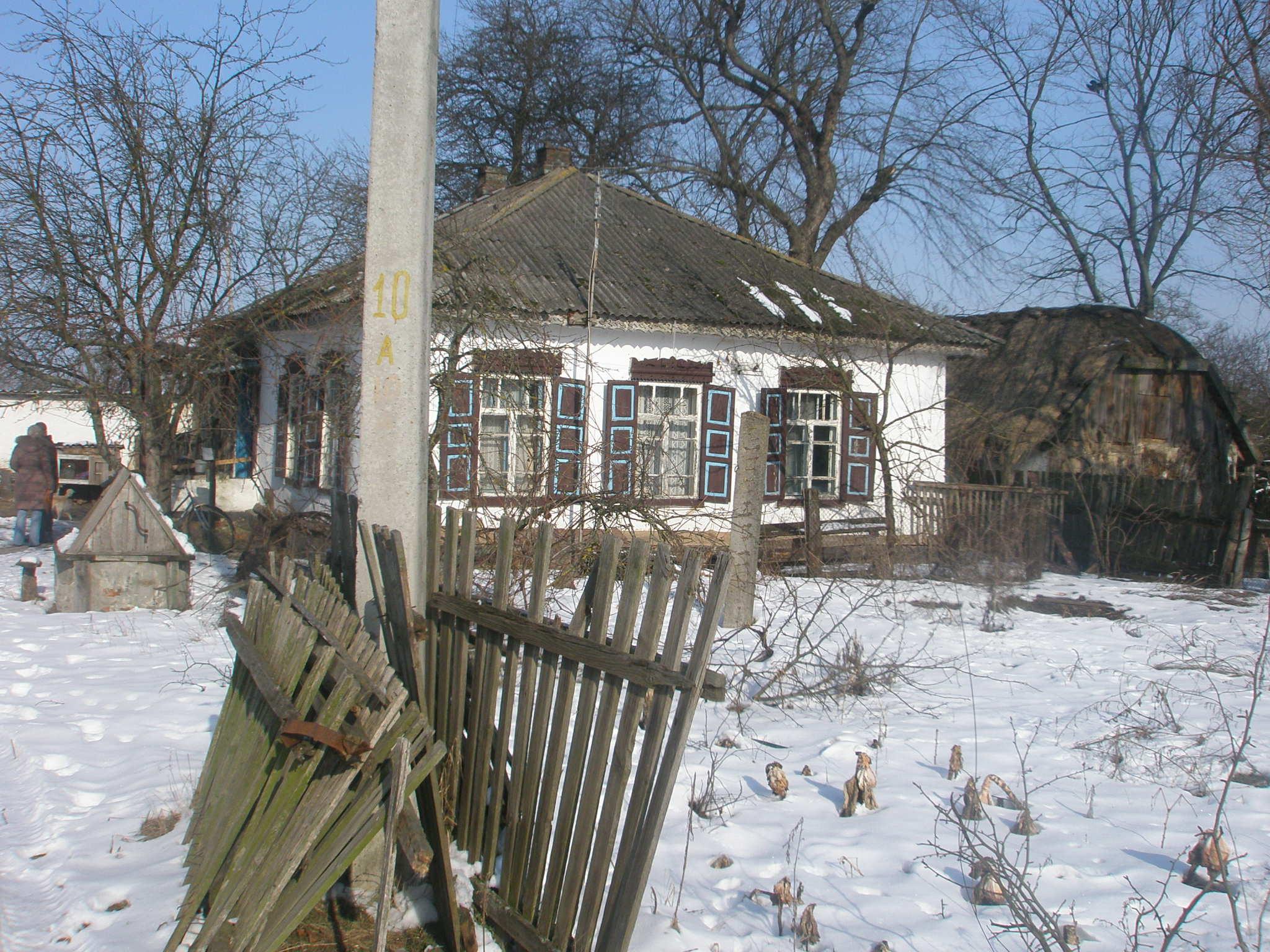 Житлове приміщення с. Коробівка, вул. Леніна, буд. 64 та земельна ділянка площею 0,25 га